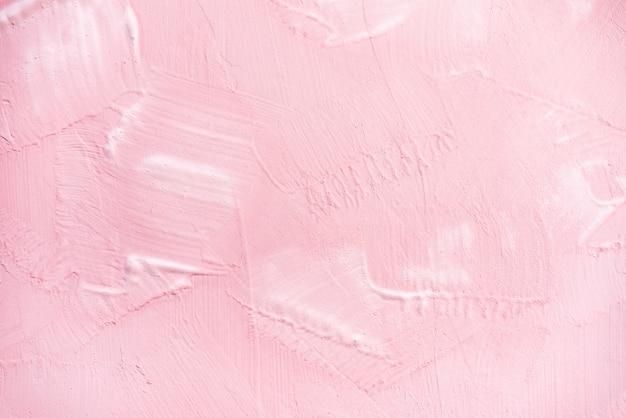 壁のテクスチャ背景にピンクのペンキ