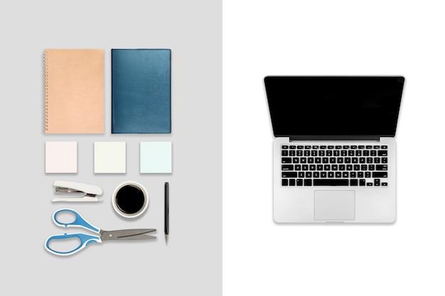 Плоская планировка офисного стола с ноутбуком, цифровым планшетом, мобильным телефоном и аксессуарами.