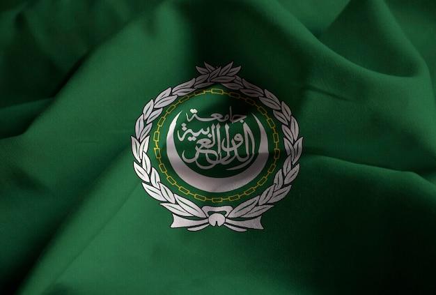 風に吹かれてアラブリーグの波立たせられた旗