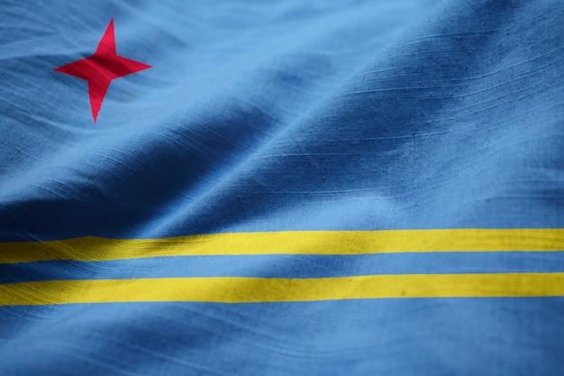風に吹かれてアルバの波立たせられた旗