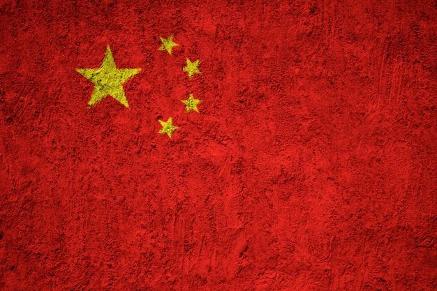 コンクリートの壁に中国の国旗