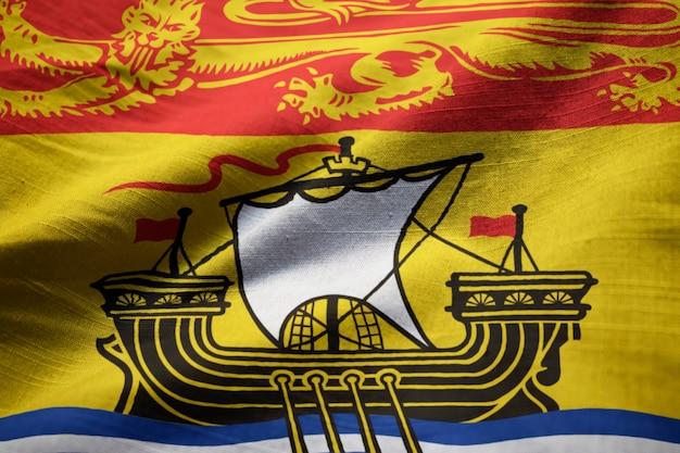 新鮮なブランズウィック旗、風に吹くニューブランズウィック旗の拡大写真