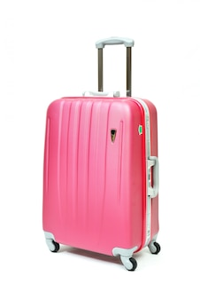 分離されたピンクの旅行荷物