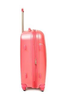 白地にモダンな大型スーツケースのピンク