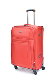 Красный современный большой чемодан на белом