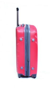 白で隔離されるピンクのスーツケース