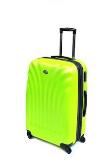 白で隔離される緑のスーツケース