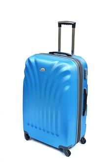白で隔離される青いスーツケース
