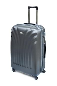 白で隔離される黒のスーツケース
