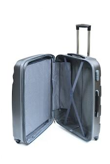 白で隔離される黒いスーツケースを開く