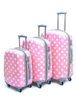 分離されたピンクのスーツケース大、中、小のセット