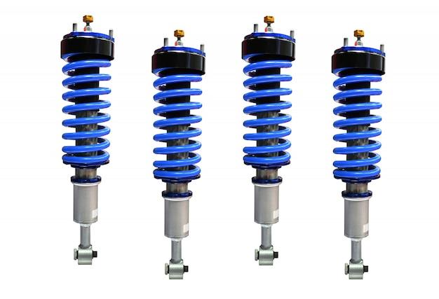 Четыре синих амортизатора на белом фоне