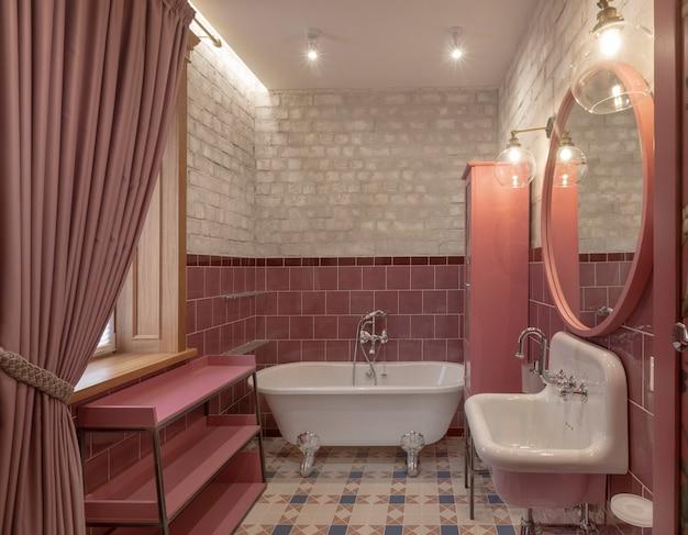 ピンク色のモダンなデザインのエレガントなバスルーム