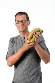 Человек с бананом на белом фоне