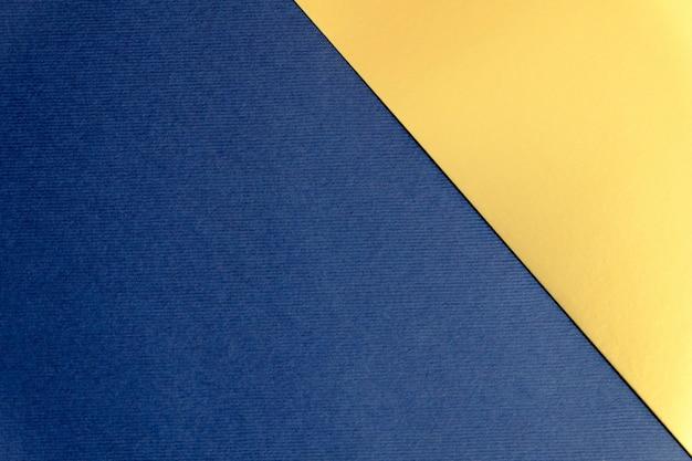ネイビーブルーとゴールドの紙のテクスチャ背景