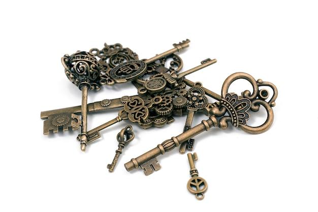 Старинные фантазийные подробные золотые ключи