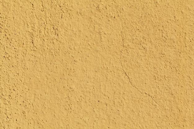 背景の黄色の壁のテクスチャ