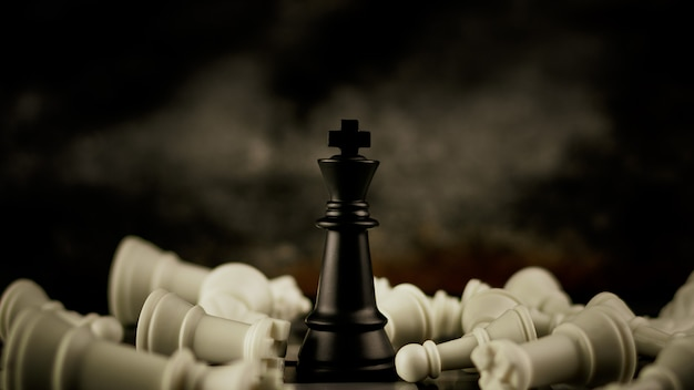 黒い王のチェスが一人で立っています。 - リーダーとビジネスの勝者の概念。