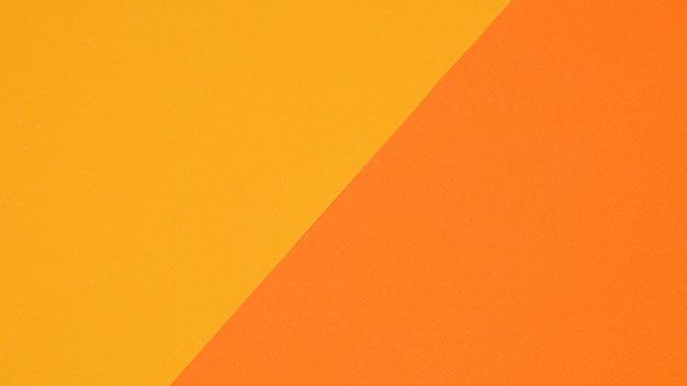 背景の黄色とオレンジ色の紙の質感