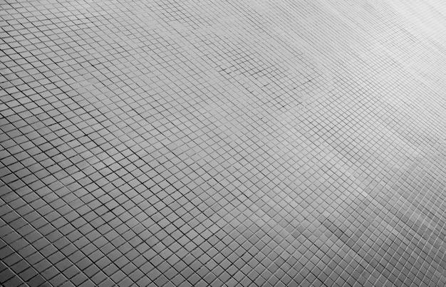 模様のある舗装タイル、セラミックレンガの床の背景 - モノクロ
