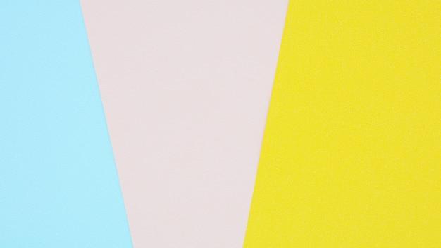 ピンク、イエロー、ブルーの紙の質感