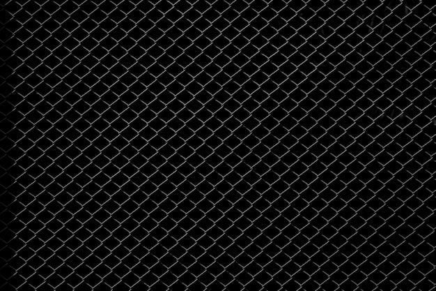 黒の背景に分離された金属製のネット