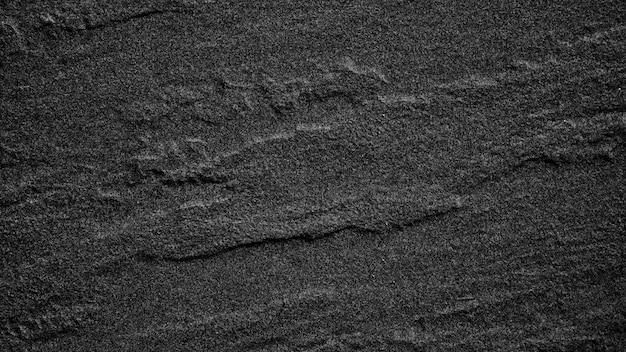 暗い灰色の黒い石のスレートの背景色または質感。