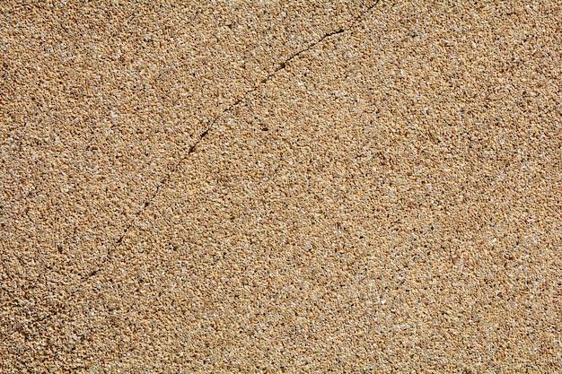 Трещины коричневой каменной стеной текстуры от землетрясения - фон