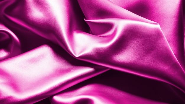 Фиолетовый волнистый шелковый фоновой текстуры