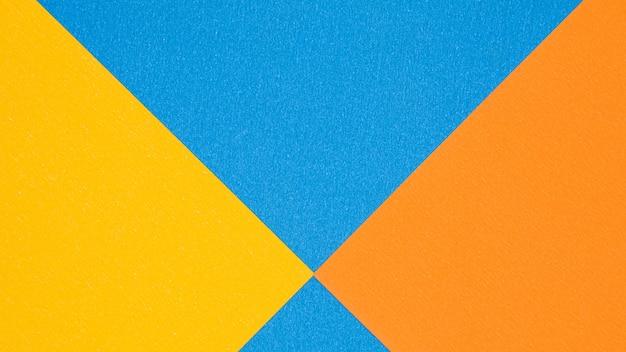 Синяя, оранжевая и желтая текстура бумаги для фона