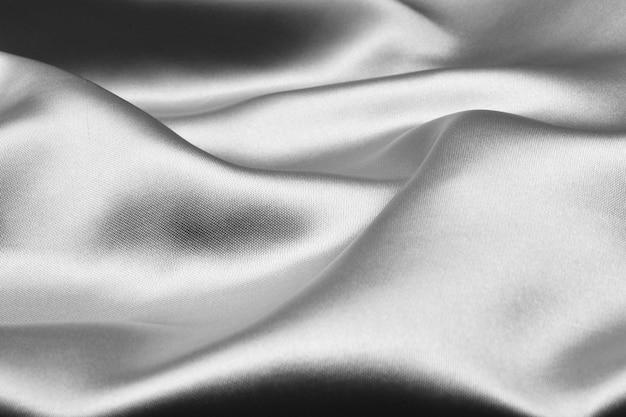 銀の波状シルク背景テクスチャ