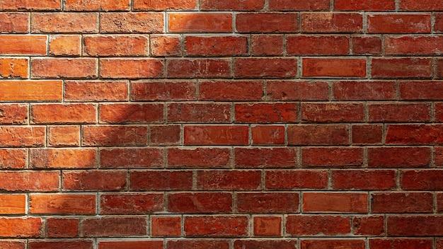 Тень на старой красной предпосылке кирпичной стены. текстура.