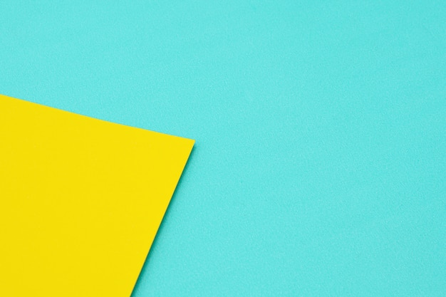 青と黄色の色紙のテクスチャの詳細。