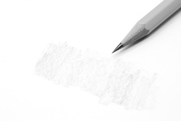 ビジネスコンセプト - 紙に書く鉛筆のクローズアップ