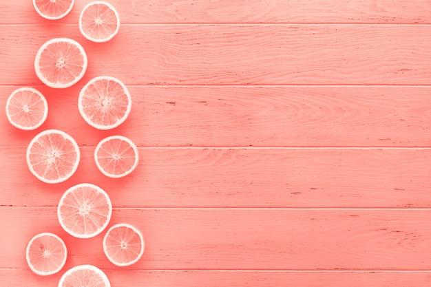 Коралловый фон тонированные апельсины
