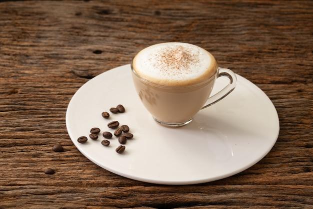 Капучино кофе прозрачная чашка на фоне дерева для кафе кафе меню
