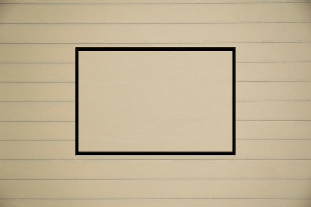 クローズアップ古い黄色/茶色のノートブック紙のテクスチャと中央の広場
