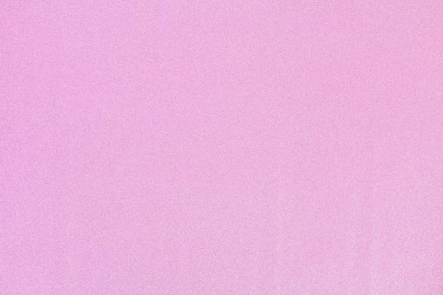 キラキラ紙の質感。上面図。ピンクのキラキラのかけら。
