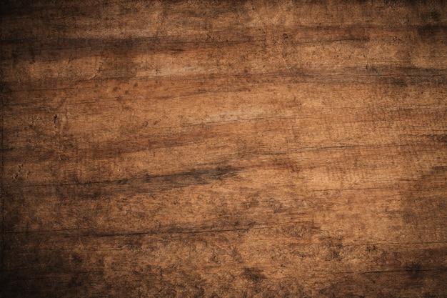 Старый гранж темный текстурированный деревянный фон