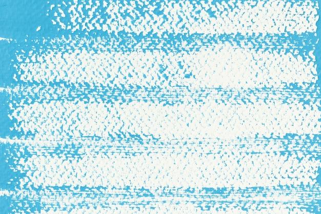 背景の白い紙の上の抽象的な青いポスターカラー