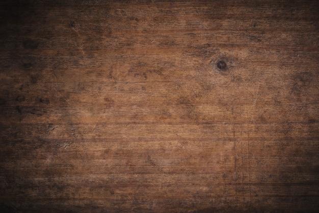 古いグランジ暗い織り目加工の木製の背景、古い茶色木目テクスチャの表面