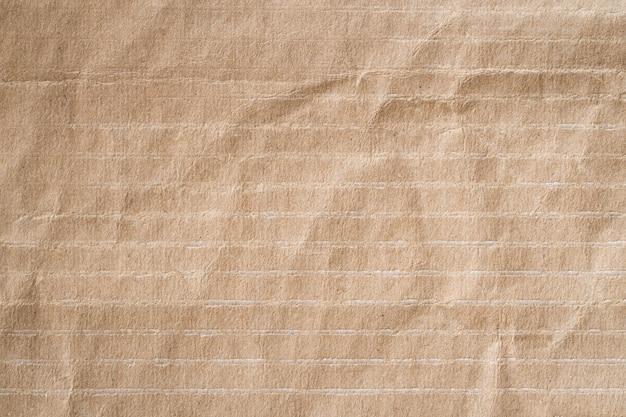 茶色の紙を丸めてテクスチャ、古い紙の背景をリサイクルします。