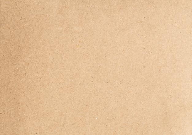 Абстрактный коричневый фон текстуры переработанной бумаги