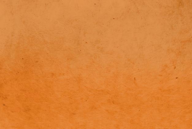 Оранжевый цвет тутового бумаги текстуры фона
