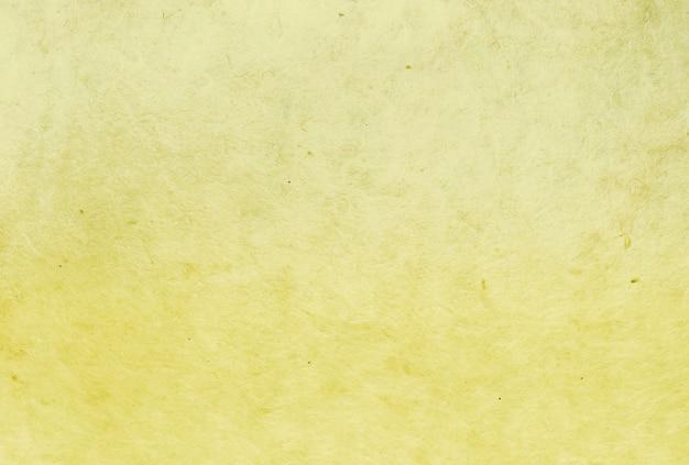 Желтый цвет тутовой бумаги текстуры фона