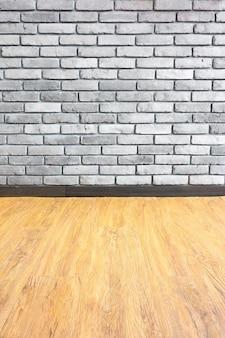 レンガの壁と木製の寄せ木細工のヴィンテージ空のインテリアパースペクティブ