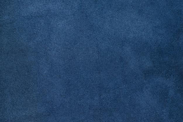 青い色が詰まった革のテクスチャの背景を閉じます