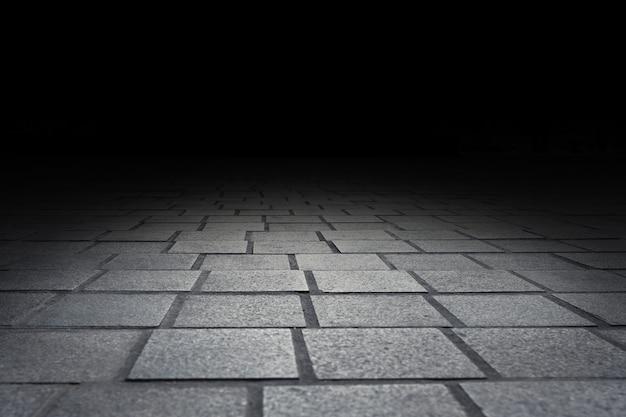 Предпосылка перспективы текстуры пола каменного кирпича мостоваой для дисплея или монтажа продукта