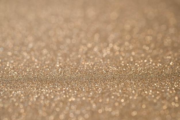 抽象的なライトゴールドの輝くキラキラの壁と床