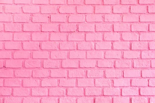 パステルピンクの順序付けられたレンガの壁のテクスチャ背景